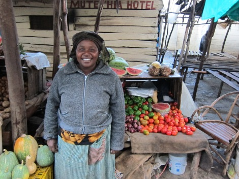 Veronica Mbithi, a Kiva borrower and farmer in Tala, Kenya, at the local market with her produce.
